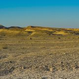Loneliness and emptiness of the desert. Loneliness and emptiness of the rocky hills of the Negev Desert in Israel. Breathtaking landscape and nature of the royalty free stock photo