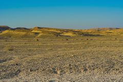 Loneliness and emptiness of the desert. Loneliness and emptiness of the rocky hills of the Negev Desert in Israel. Breathtaking landscape and nature of the stock image
