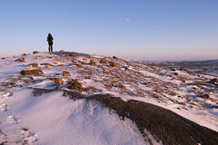Loneliness in the ice. A man standing on a rock in the Arctic Stock Image