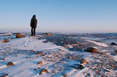 Loneliness in the ice. A man standing on a rock in the Arctic Stock Images