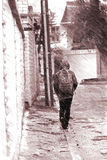 Loneliness. Lonely man walking in the rain Stock Photography