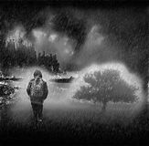 Loneliness. Lonely man walking in the rain Royalty Free Stock Photography