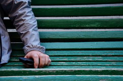 Loneliness. A man sitting on a bench Stock Photography