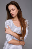Loneliness. Pretty woman looking down Royalty Free Stock Photo
