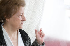 Loneliness senior woman Stock Image