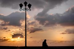 Loneliness Silhouette conceptual shot and sunset