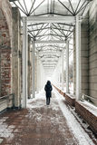 Loneliness woman walking on bridge. Loneliness woman walking on bridge in snowing day Stock Photos