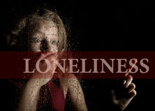 Loneliness written on virtual screen. hand of frightened young girl melancholy and sad at the window in the rain. Loneliness written on virtual screen. hand of stock photography