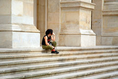 Lonely. Girl standing on wide stairs thinking waiting Stock Photo