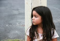 Lonely. A little girl lonely at the street Royalty Free Stock Images