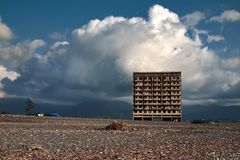 Abadoned building at the beach of the Kobuleti Georgia. Lonely abadoned building at the beach of the Kobuleti Georgia with small houses and mountains on the Royalty Free Stock Photos