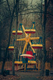 Lonely abandoned carousel attraction in the autumn park Royalty Free Stock Image