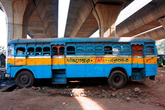 Lonely Abandoned Multicolored Bus Stands Under The Motorway Stock Image
