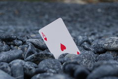 Lonely Ace Of Hearts. Ace of hearts in dark stones Royalty Free Stock Photography