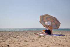 Lonely adult woman on the beach. Lonely adult woman overweight on the beach Stock Images