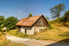 Lonely Aged House in Mountains Stock Photography
