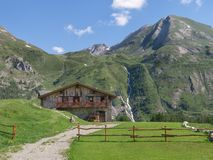 Mountain cabin nestled in the Alps stock images