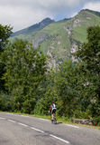 Lonely Amateur Cyclist. Laruns,France,July 15th 2011: Image of a lonely amateur cyclist climbing on the road to mountain pass Aubisque just before the passing of Royalty Free Stock Photos