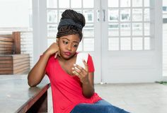 Free Lonely And Sad African American Woman Waiting For Message Stock Images - 128167624