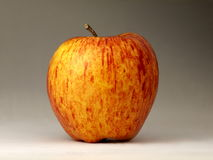 Lonely apple. Red and yellow apple on the table Stock Images