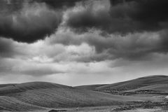 Lonely Art Nature Hills under cloudy sky. Stormy weather black and white image Stock Photography