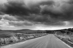 Lonely Art Nature Hills under cloudy sky. Stormy weather black and white image Royalty Free Stock Image