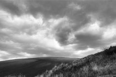 Lonely Art Nature Hills under cloudy sky. Stormy weather black and white image Royalty Free Stock Photos