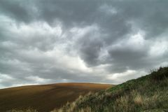 Lonely Art Nature Hills under cloudy sky. Stormy weather color image Royalty Free Stock Photo