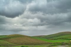 Lonely Art Nature Hills under cloudy sky. Stormy weather color image Royalty Free Stock Images