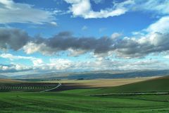 Lonely Art Nature Hills under cloudy sky. Stormy weather color image Stock Photo