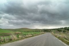 Lonely Art Nature Hills under cloudy sky. Stormy weather color image Royalty Free Stock Photos