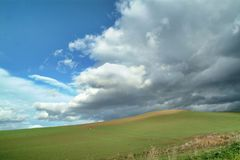 Lonely Art Nature Hills under cloudy sky. Stormy weather color image Royalty Free Stock Photography