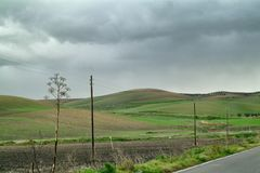 Lonely Art Nature Hills under cloudy sky. Stormy weather color image Stock Images