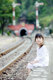 Lonely asian girl on the train station Royalty Free Stock Image