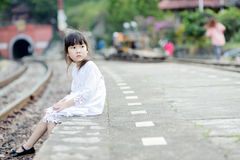 Lonely asian girl on the train station Royalty Free Stock Photos
