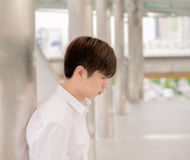 Lonely Asian Man  Lean the Pole Royalty Free Stock Photos