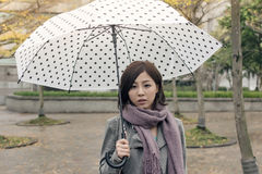 Lonely Asian woman Royalty Free Stock Image