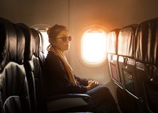 Lonely asian woman sitting beside plane window use for traveling Stock Photography