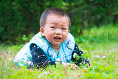 Lonely baby is very sad(Asia, China, Chinese) Royalty Free Stock Image