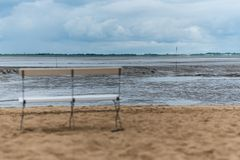 A lonely bank on a beach at ebbe stock photo