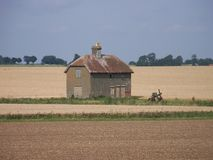 Lonely Barn in the middle of farm fields Royalty Free Stock Photography