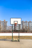 Lonely baseketball hoop. Stand in front of buildings royalty free stock photo