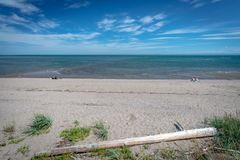 Lonely bathers on the beach of St.Irenee, Quebec royalty free stock images
