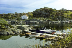Lonely Bay at Norway. Some boats in a small bay harbour at Norway Stock Photo