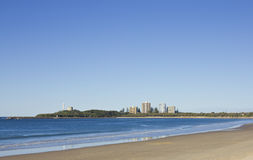 Lonely Beach. Small waves distant buildings. Mooloolaba, Queensland, Australia, a favourite holiday destination royalty free stock image