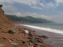 Lonely beach. Isolated,  rocky, red sandy beach  in Aspy Bay, Cape Breton, Nova Scotia Stock Photography