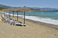 Lonely beach beds Stock Photography