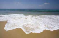 Lonely beach with gentle waves Stock Photography