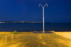 Lonely beach shower. Night view of a lonely shower in a beach Royalty Free Stock Photography