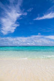 A lonely beach. With turquoise water stock photo